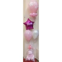 Composición de globos con peluche